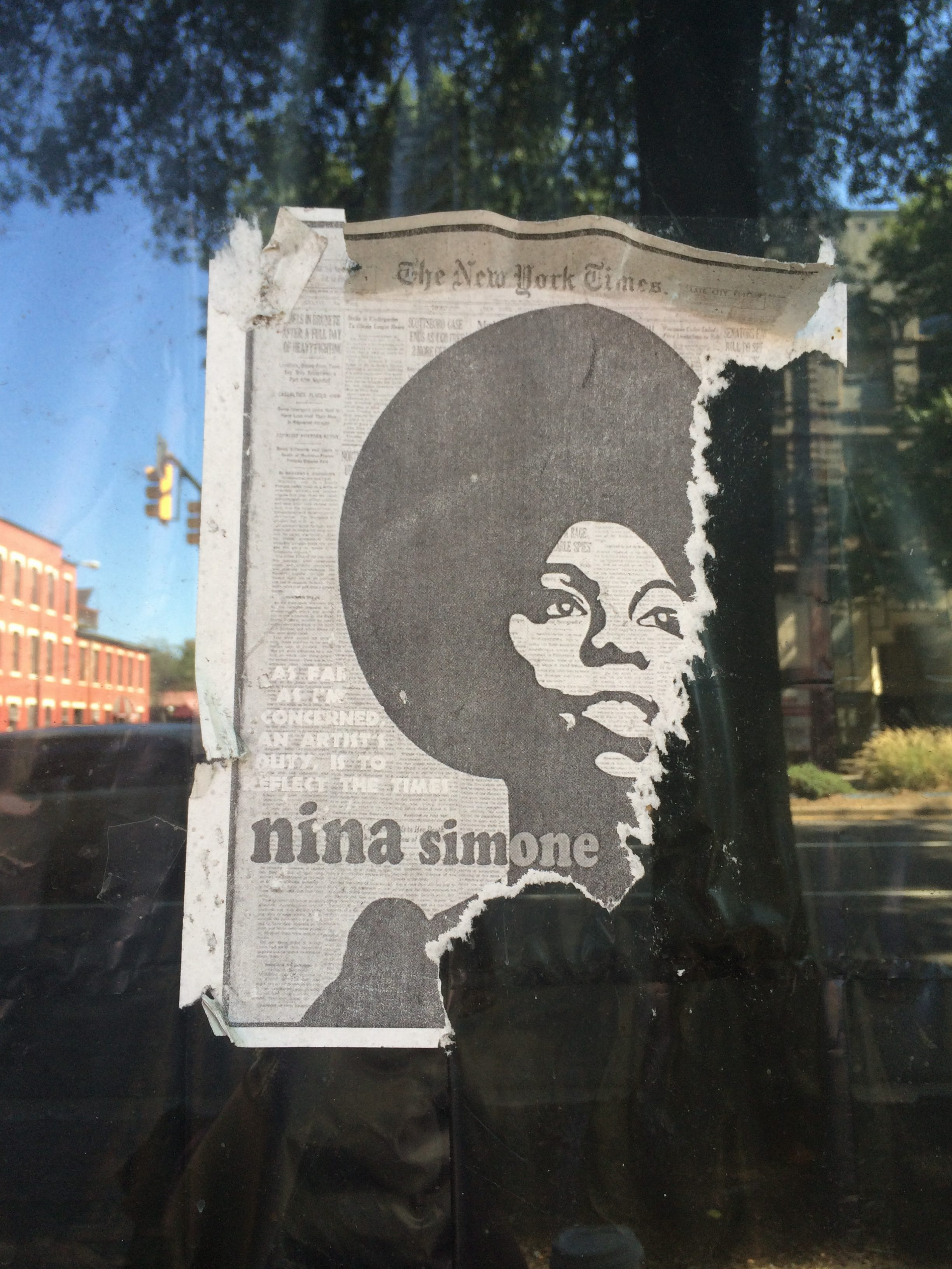 A picture of Nina Simone is screen printed on top of an old New York Times.